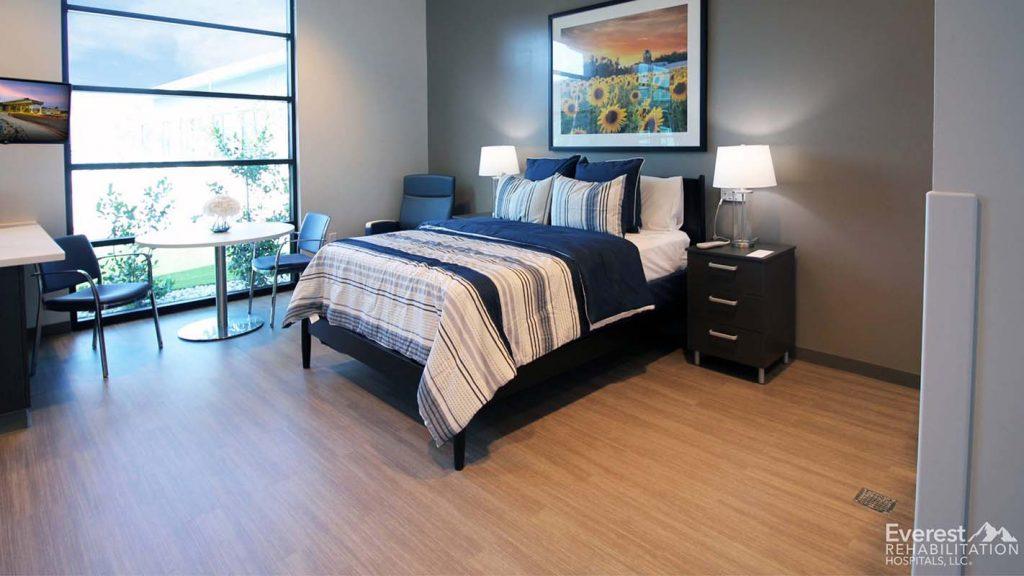 lvt flooring in a bedroom used to mimic hardwood flooring